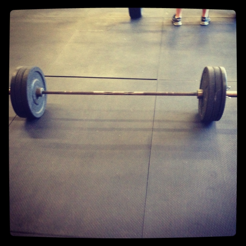 Don't be too impressed it's only 125lbs. We were doing the Clean and Jerk and I had a few moments to quick snap a picture.