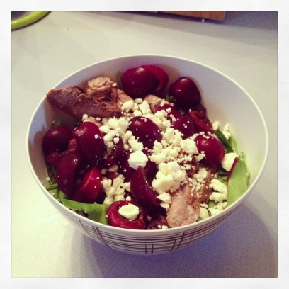 The resulting salad: cherries, marinated steak, mixed greens and feta. Delicious.