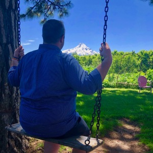 Photo of the blogger in Portland, Oregon with Mt. Hood in the background.